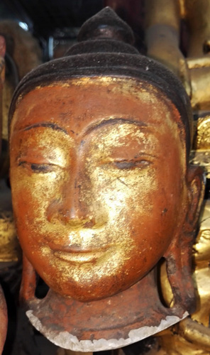 Buddha's head, sold by one>