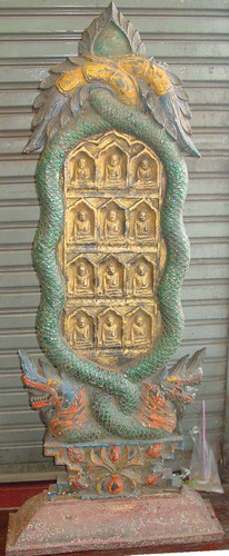 Votive plaque with Buddha images and naga
